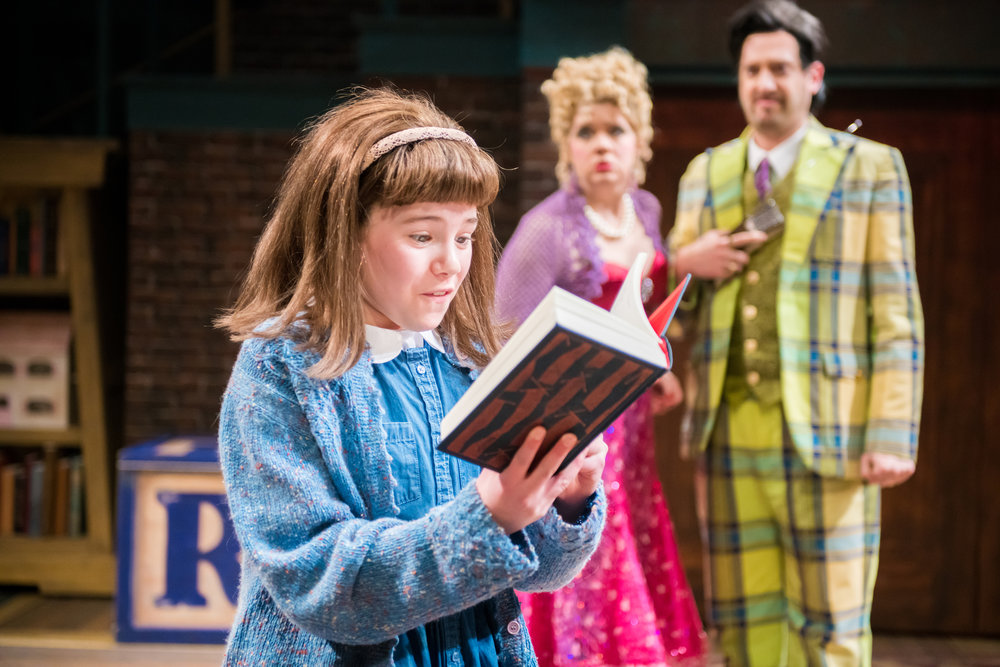 "Reese Bell, Molly Rhode and Jackson Evans in First Stage's ""Matilda."" Photo by Paul Ruffolo."