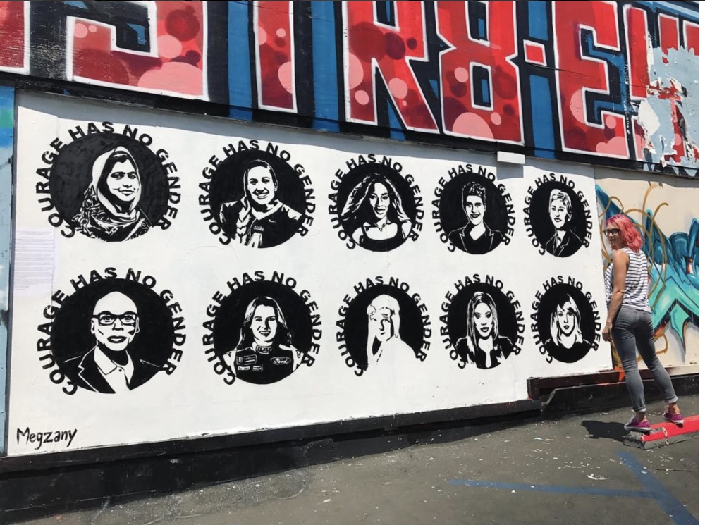 Artist Meg Zany stands by her piece which celebrates women who have challenged the status quo. Top Row From Left: Malala Yousafzai, Becca Longo, Serena Williams, Rain Dove, Ellen Degeneres.  Bottom Row From Left: Ru Paul, Danica Patrick, Amelia Earhart, Laverne Cox, Taylor Swift