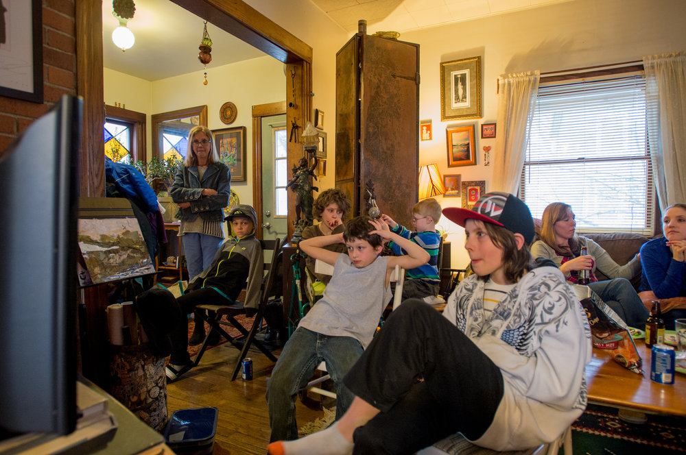Carol Heveron (far left) watches over her relatives and grandchildren as they watch TV at her house on Easter Sunday.