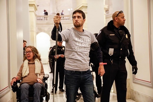 Ady Barkan on Capitol Hill.  Watch him  address Senator Flake on an airplane.