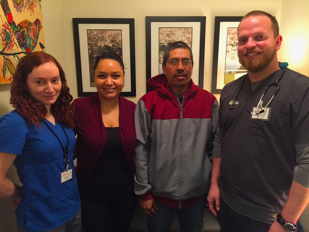"One Community Health's ""Pink Team"" stepped up and provided speedy, high-quality care for Inocent Giles. Shown here (left to right): Erin Krupp, RN, Flor Meza (team assistant), Inocente Giles, patient, and Adam White, RN."