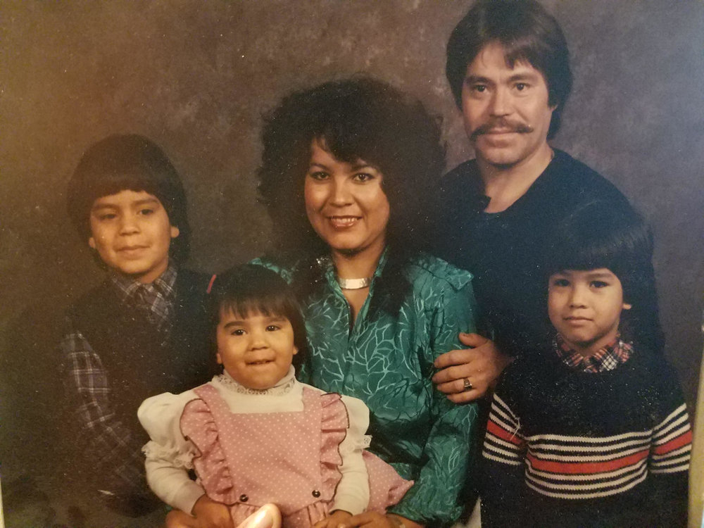 Villalobos, pictured here in pink, is surrounded by her family members during the time when they were patients at One Community Health, formerly La Clínica del Cariño.