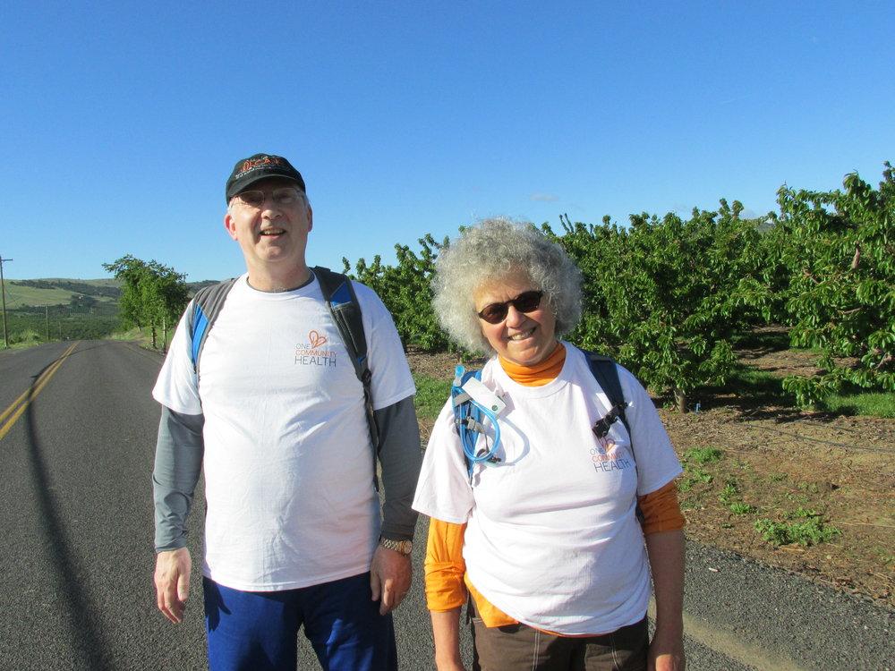 Tina Castañares, along with One Community Health's CEO David Edwards, at the 2016 Northwest Cherry Festival 5K/10K walk/run.