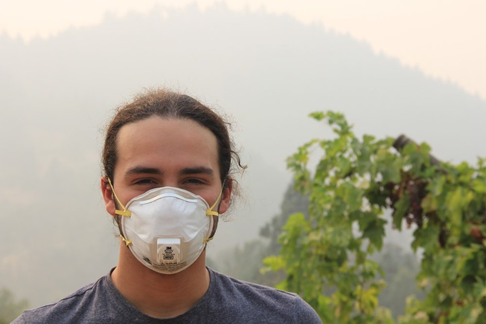 Jacob wearing a mask while working on his family's farm in Oregon this summer, when the smoke from nearby wildfires made it unsafe to breathe normally outside.