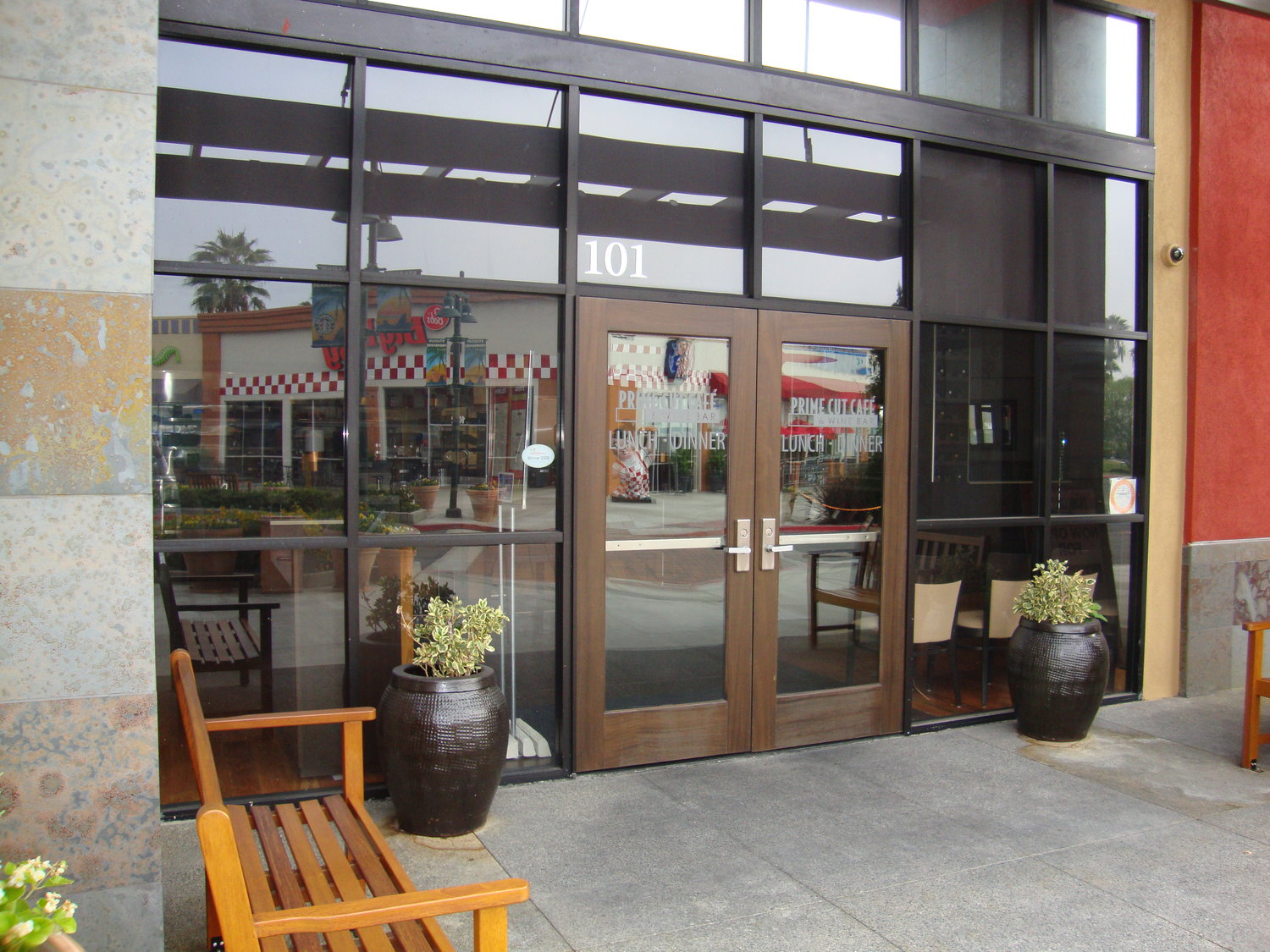 Storefronts — Orange Mirror and Glass