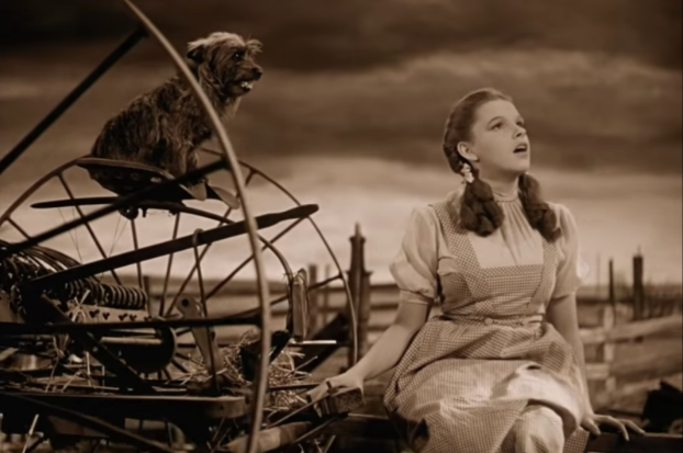 Dorothy and Toto in Kansas, which is intentionally shot in sepiatone