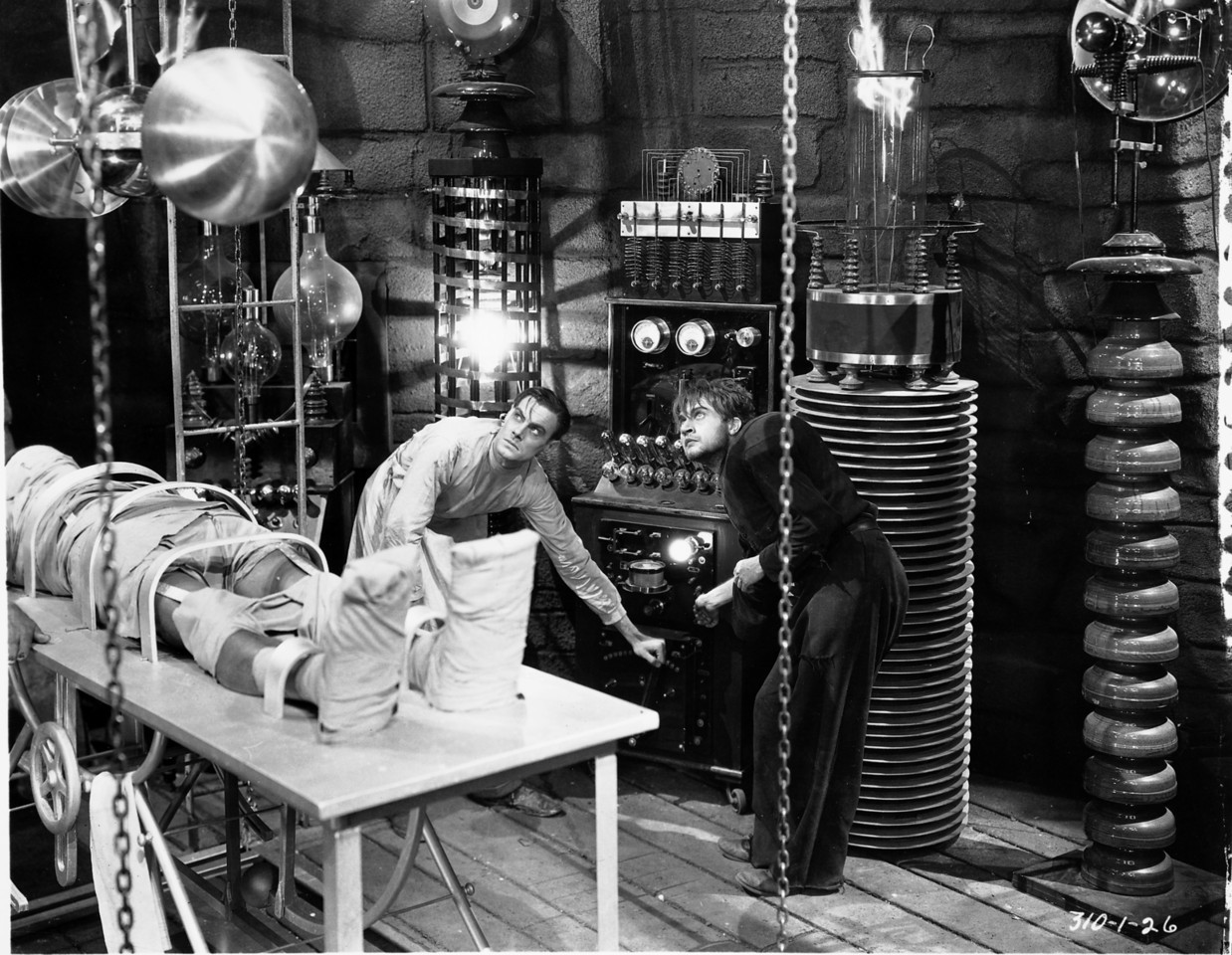 Frankenstein (Colin Clive) is in between his assistant Fritz and his Monster. Notice how both Frankenstein and the Monster brightly stick out in the picture. (Photo Credit: IMDB)