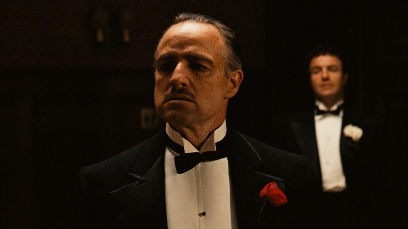 The Godfather Vito Corleone (Marlon Brando) with his son Sonny (James Caan) in the background. Notice the minimal lighting in this shot. (Photo taken from IMDB)