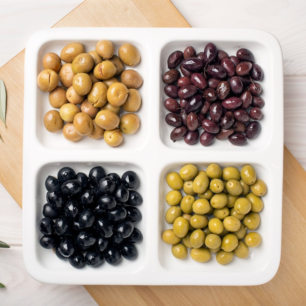 6. Opt for an Olive Bar - One of my very favorite things to host for fall is an olive bar! The green, purple and brown colors are perfect for the autumn season. Your local grocer is a great place to find kalamata olives, green olives, and stuffed olives or you can get a variety of olives in bulk or in small glass jars at markets. Along with your olive bar, it's fun to have a fresh loaf of bread or a baguette that can be dipped in a variety of olive oils and vinegars.