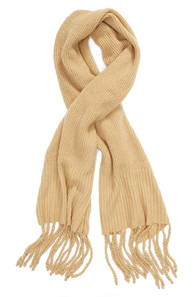 2. Oversized Scarf - An oversized scarf is the perfect way to turn any outfit into something warm and cozy. Be sure to pick a style and color that will pair with multiple items in your closet, and we recommend paying close attention to the fabrication of the scarf in case you have specific fabrics you like to avoid such as wool or acrylic. We love both of these cozy scarf options from Free People that you can get directly from Amazon. The Jaden Ribbed Fringe Blanket Scarf pairs with any outfit and adds extra warmth and texture to your cozy fall looks.