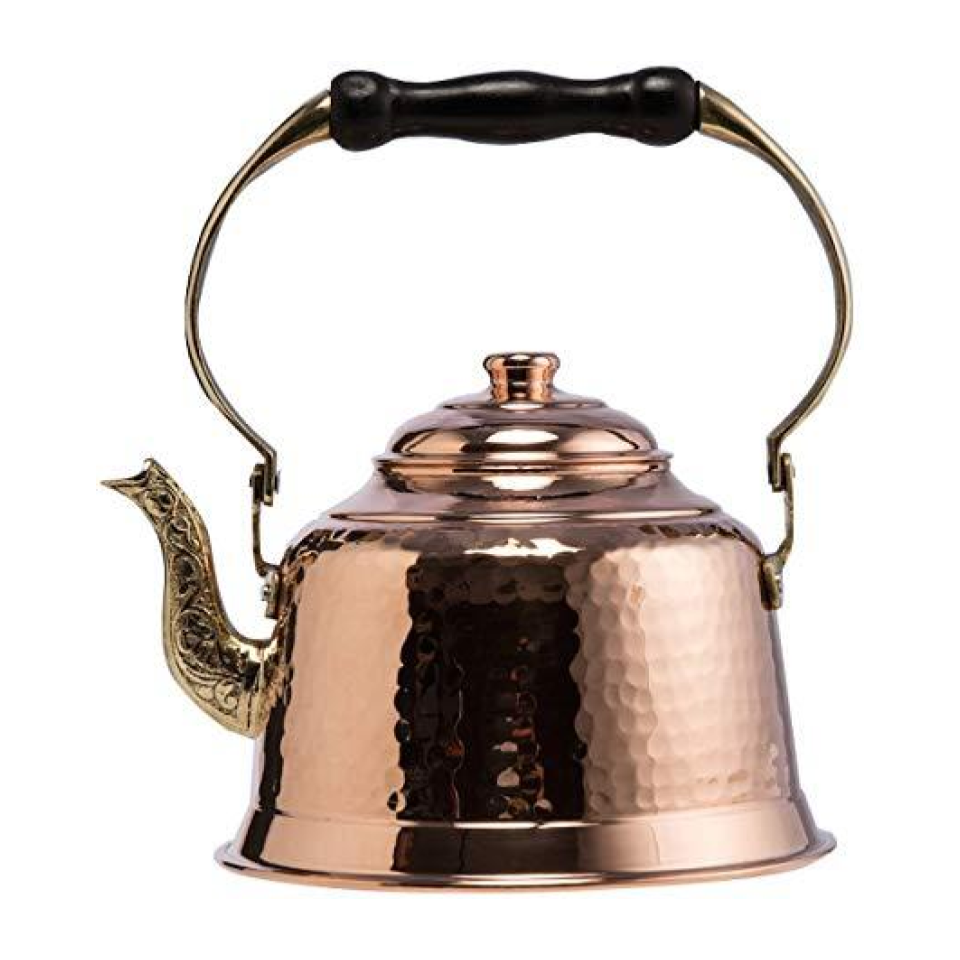 Hammered Copper Tea Kettle - This hammered copper tea kettle is handmade in Turkey and showcases a uniquely carved spout and wooden handle. A Kitchen must-have!
