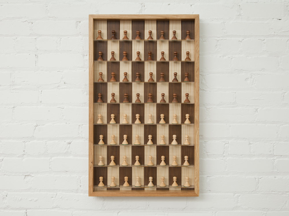 "New Economy Chess Board    31.5"" x13""    birch inlay and plexi in frame    2017"