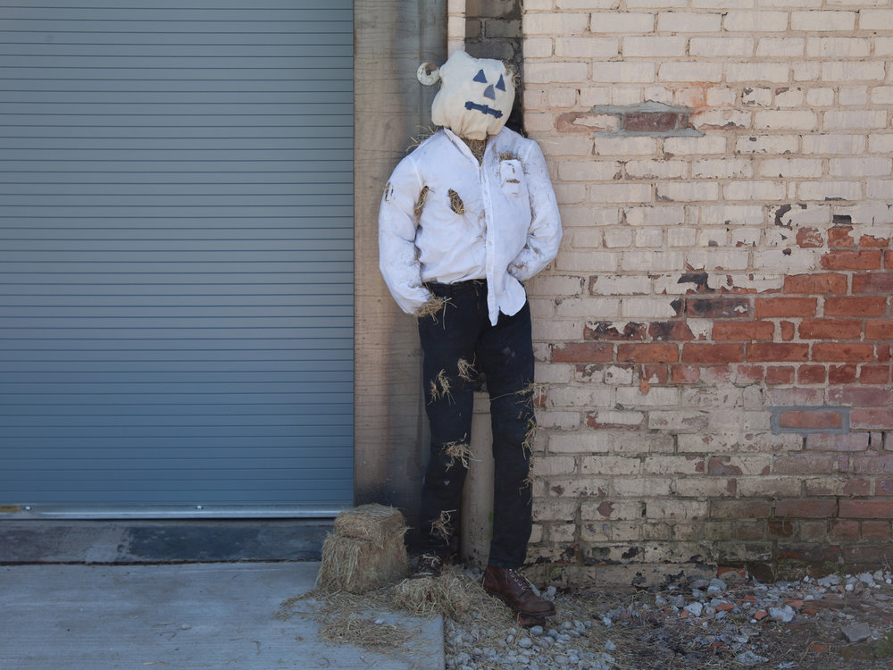 """Automated Promotion or Dire Warning? This Scarecrow Playing A Live Feed of a Conversation Taking Place Inside at Full Volume Outdoors Will Get The Business You Place it in Front of Whatever Customers It Deserves    72""""x 14""""x 18""""    clothing straw wood substructure speakers    2017"""