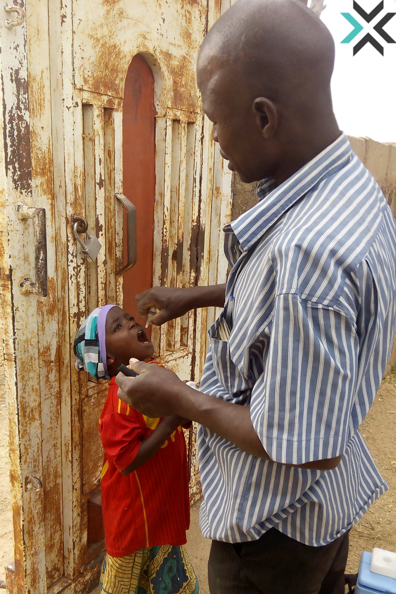 A Child Receiving Polio Medication in Uba City