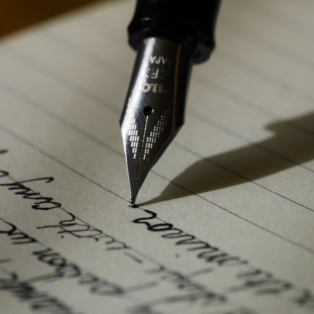 notebook-writing-hand-pen-diary-finger-637740-pxhere.com-min.jpg
