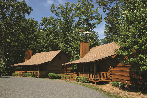 LOG CABINS Learn More →