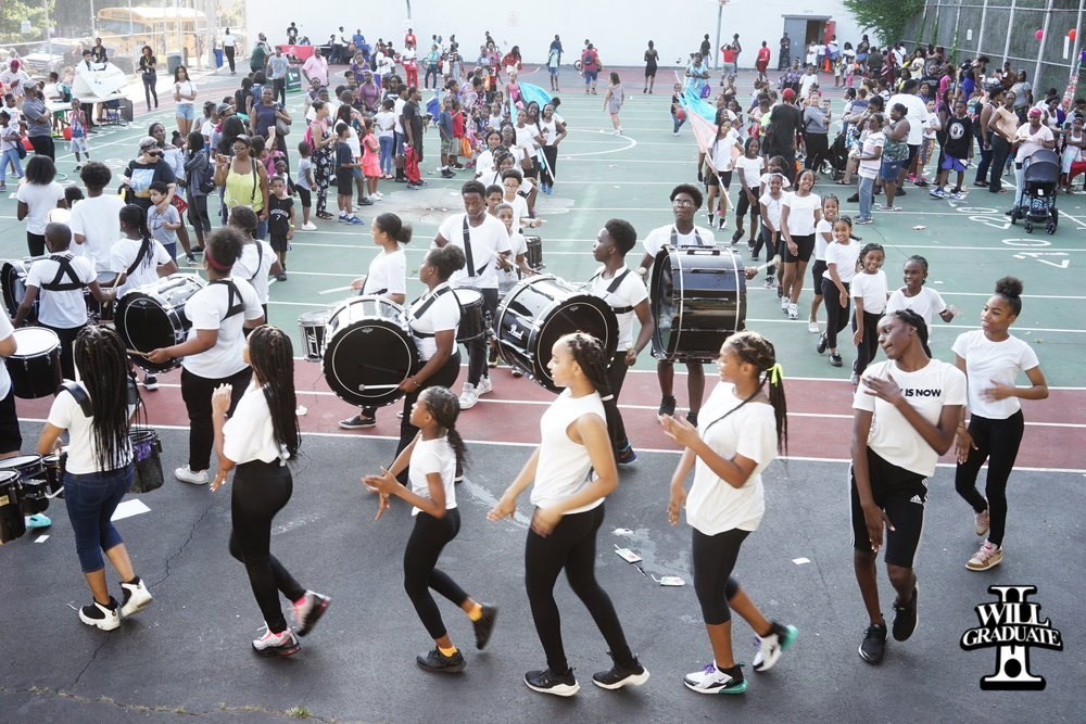 Soul Tigers Perform at I WILL GRADUAte Back to School Yard Party.