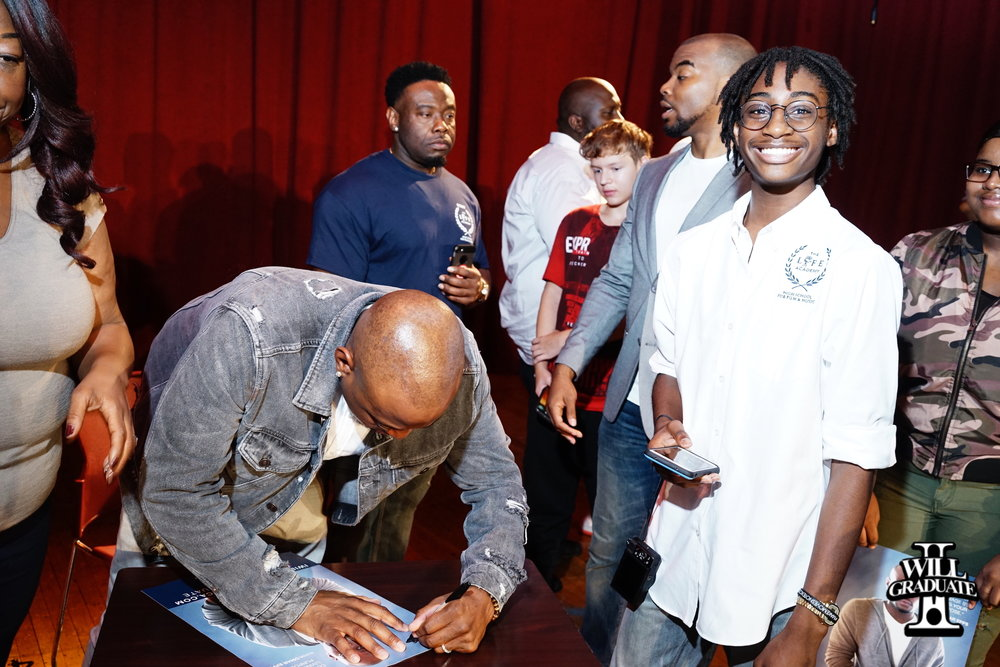 Omar epps signs poster for students.jpg