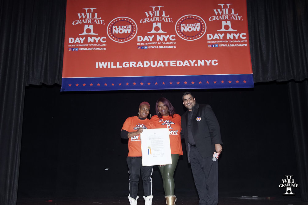 Tónya Lewis Taylor accepts proclamation from The City of New York