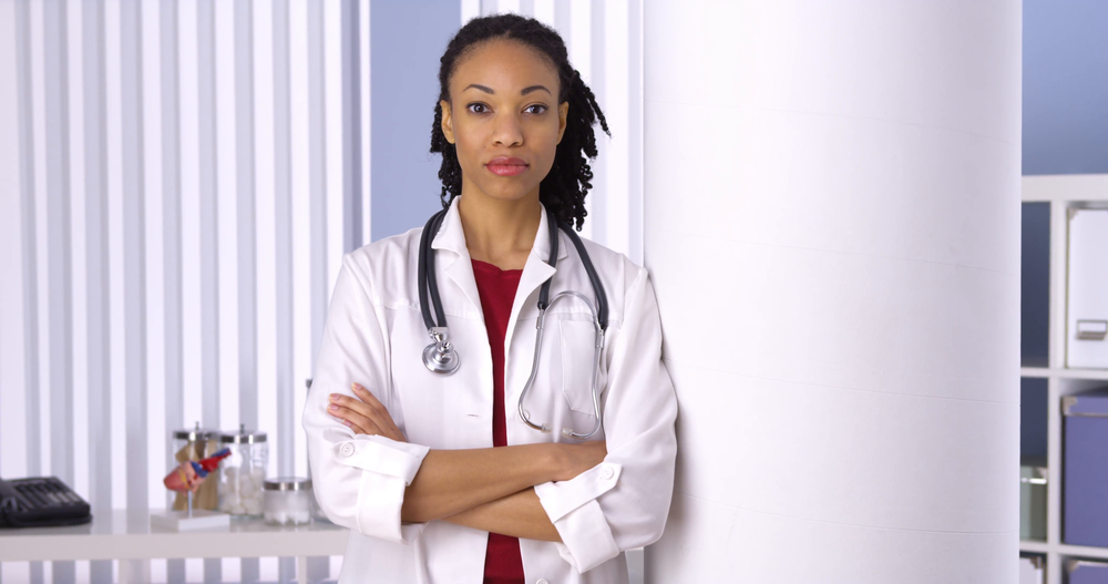 successful-black-woman-doctor-standing-in-office_vk1ibjfbe__F0000.png