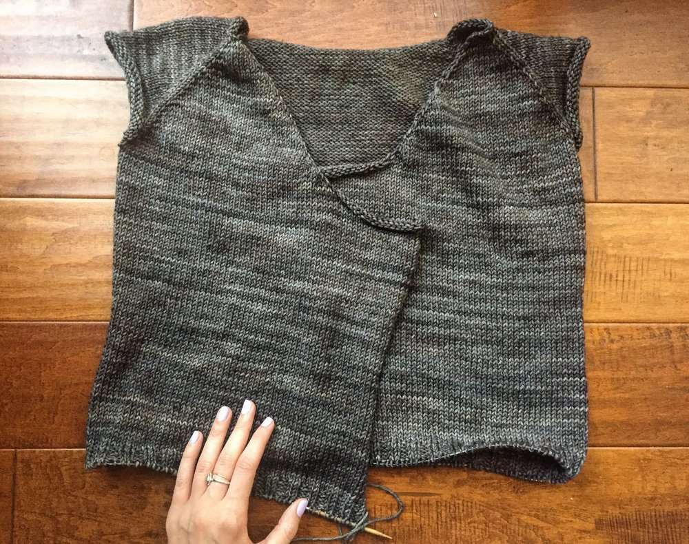"""Effortless Cardigan, body. I have about 2"""" of bottom ribbing left. OBVIOUSLY I still need to knit the sleeves. You're a ding dong if you thought I'd leave it like this."""