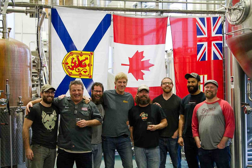 """Photo: Garrison Brewing Company (Nova Scotia) - Central City Brewers + Distillers (BC) - Beau's Brewing Company (Ontario) teams collaborating in the   Red Racer Across the Nation Collaboration 12-pac k  to celebrate #Canada150."" courtesy Central City Brewers + Distillers"