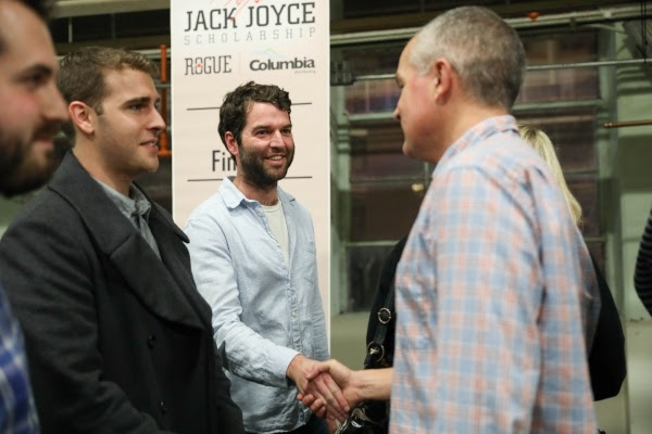 Brett Joyce congratulates Jack Joyce Scholarship Award winner Evan Trapp who received $15,000.
