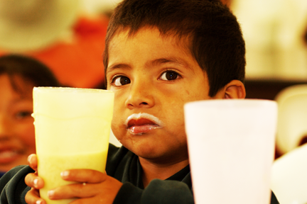 2017_january_baja_outreach_boy drinking milk.png