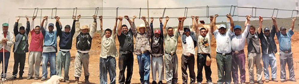 rancho de cristo_men holding ladder.png