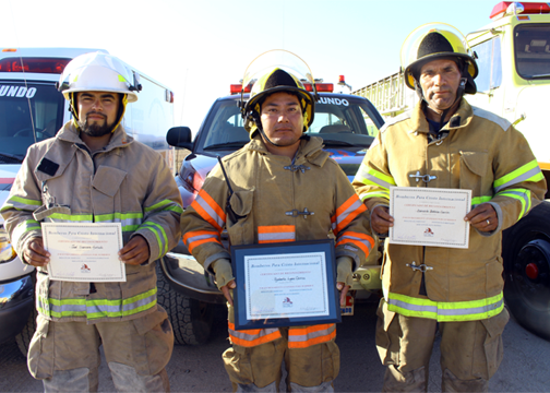 Firefighters receiving a reward