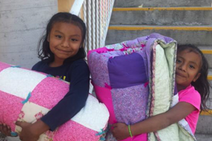 oaxaca_girls with quilts.png