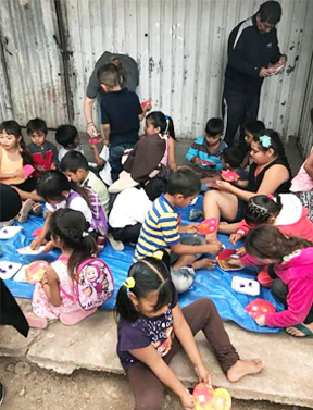 sinaloa_children eating at camp.png