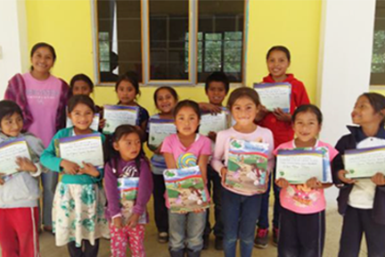 oaxaca_children with certificates_tere in the mountains.png