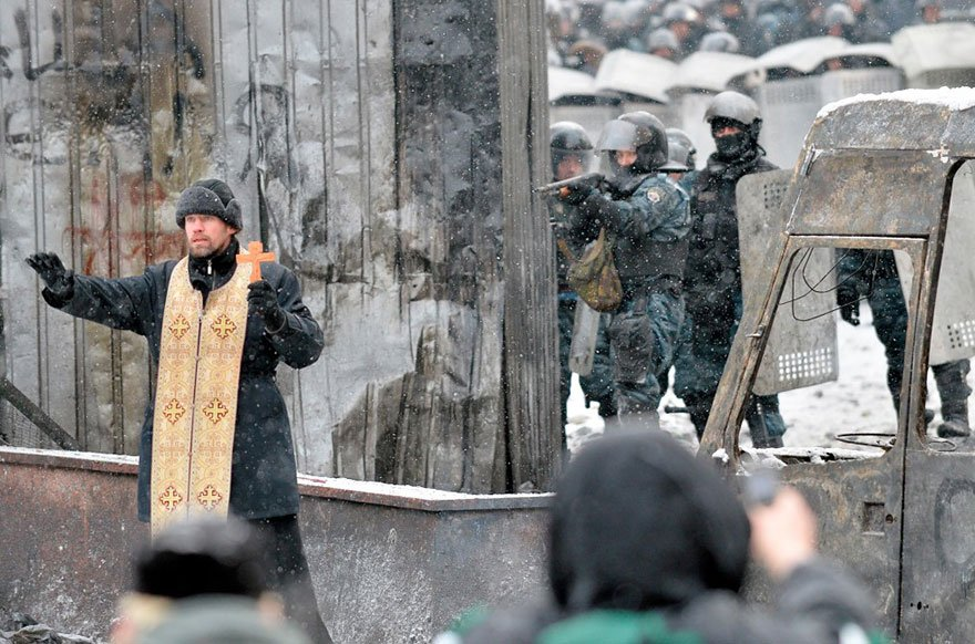 Abbey Meditation:   Jan. 22, 2014 – An Orthodox priest tries to stop a clash between protesters and the police in the center of Kiev, Ukraine. Anti-government street protests in Kiev turned deadly overnight, as opposition organizers announced that three demonstrators had been killed, one from a fall and two shot by police.    Sergei Supinsky / AFP/Getty Images   For me, this is such a tangible picture of what Christ has called us to be as the church, what it means to be a peace maker in our city.  Lord may you grant us strength. May you bring peace where there is war, hope where there is despair, light to where there is darkness and healing where there is pain. May you love with our hearts, speak with our lips, serve with our hands and create with our minds.