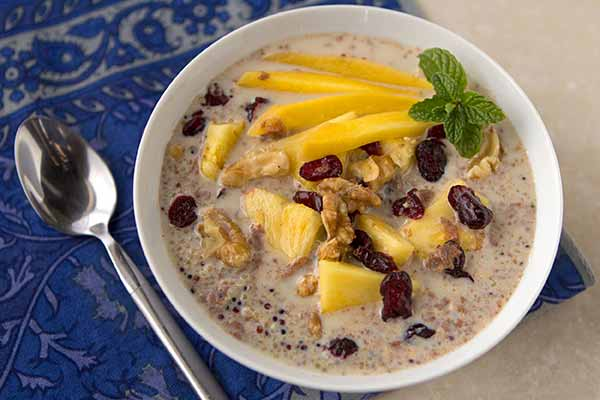 Incan Quinoa Blend Porridge with Tropical Fruit - Fruity, protein-packed quinoa porridge makes an easy and tasty campground breakfast. Just boil quinoa for 12 minutes, fluff with a fork, and stir in almond or coconut milk, fruit and optional brown sugar.