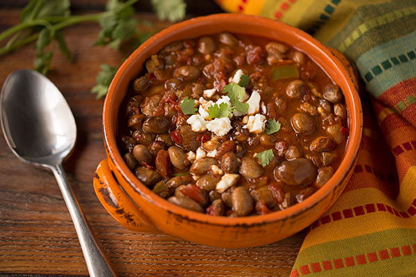Frijoles Charros - Frijoles charros were made for eating around the campfire. Really, they were. This dish is named for the charros, traditional horsemen from central Mexico. Just like the cowboys of the American west, they are said to have eaten beans during their travels as they were highly portable and required so few ingredients. Just remember to soak your beans overnight so that they cook quickly.