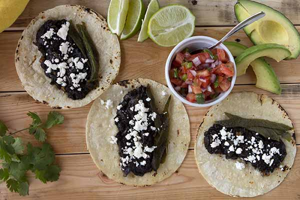 Huitlacoche Tacos - If you've never tried huitaloche, you're in for a treat. Huitlacoche is actually a fungus that grows on corn, and it is considered a delicacy in Mexico where it's typically used as a filling for quesadillas, soups and tacos. In these simple tacos, the earthy, mushroom-like flavor of huitlacoche is paired with the spicy heat of poblano chiles. The result is a deliciously rich, yet simple to make thanks to our canned huitlacoche.