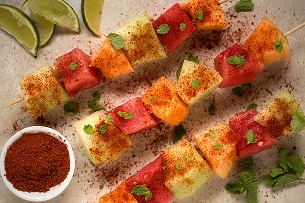Chile-Lime Melon Skewers - Our Chile-Lime Seasoning lends a mildly spicy, citrusy note to fresh chopped melon, making a refreshing snack that's perfect for a summer camping trip.