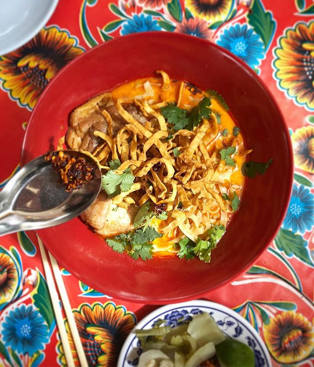 Khao Soi with chicken, our secret curry paste recipe and house-pressed fresh coconut milk. Served with house pickled mustard greens, shallots, crispy yellow noodles and roasted chili paste - garnish however you'd like. #northernthaifood #pokpoknoi