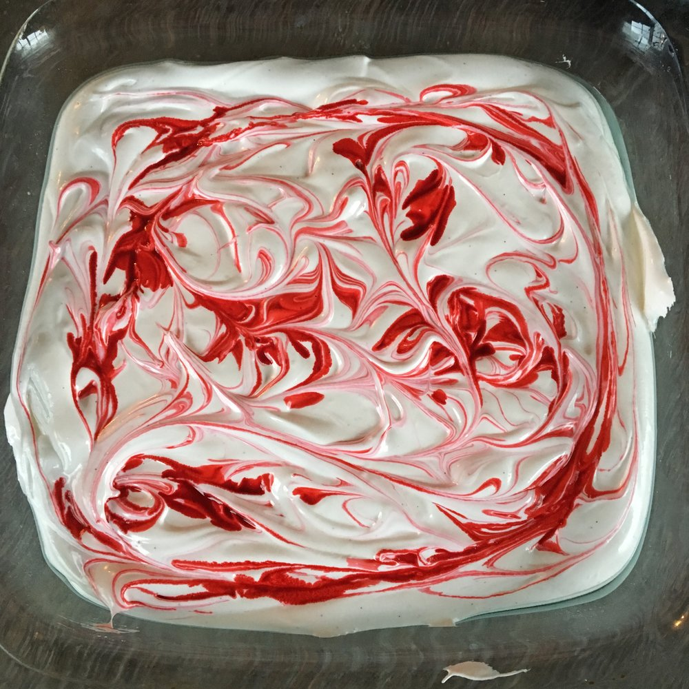 Add drops of red food dye and swirl into shapes with a toothpick to make marbled marshmalows.