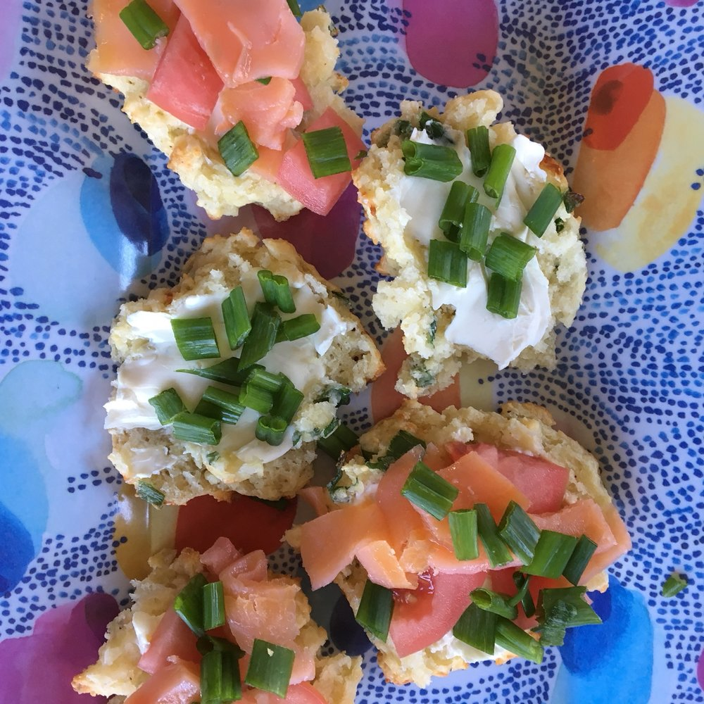 """Pictured with our """"Morning is for Mimosas Kit."""" My favorite pairing for these tasty biscuits is with tomatoes, lox, cream cheese and scallions. Put the toppings on the side so that guests can build their own creation."""