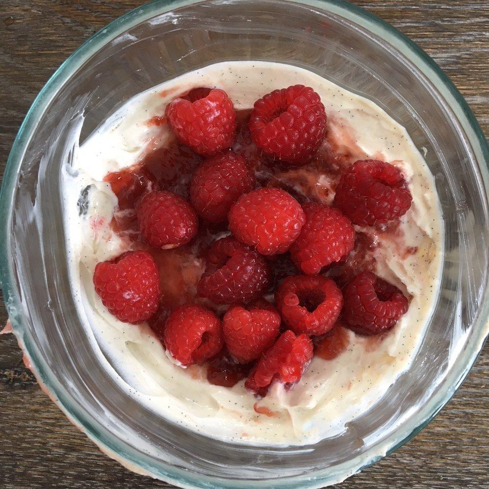 Vanilla bean yogurt with Stonewall Kitchen strawberry champagne jam and raspberries.