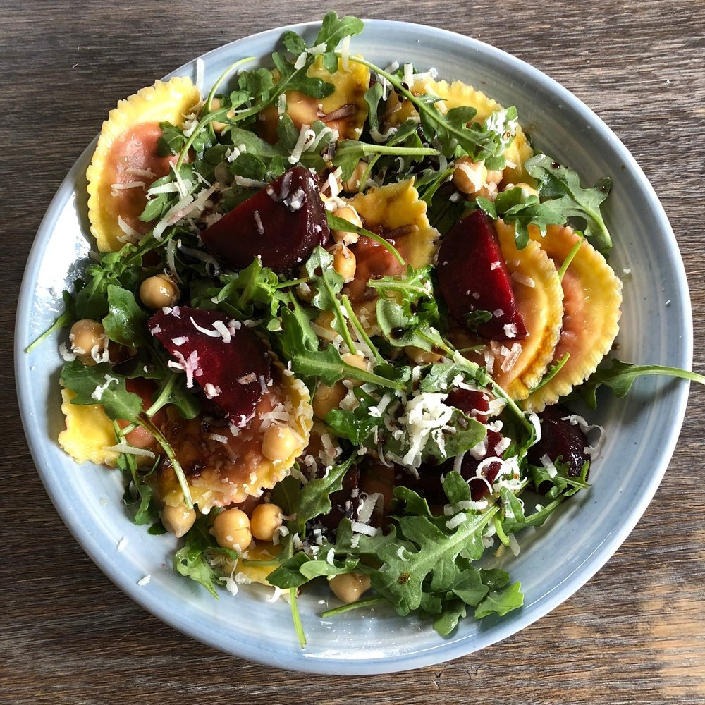 Red beet mezzelune pasta salad with garbanzo beans, arugula, shredded parmesan, olive oil and vinegar. A yummy quick dish for lunch.