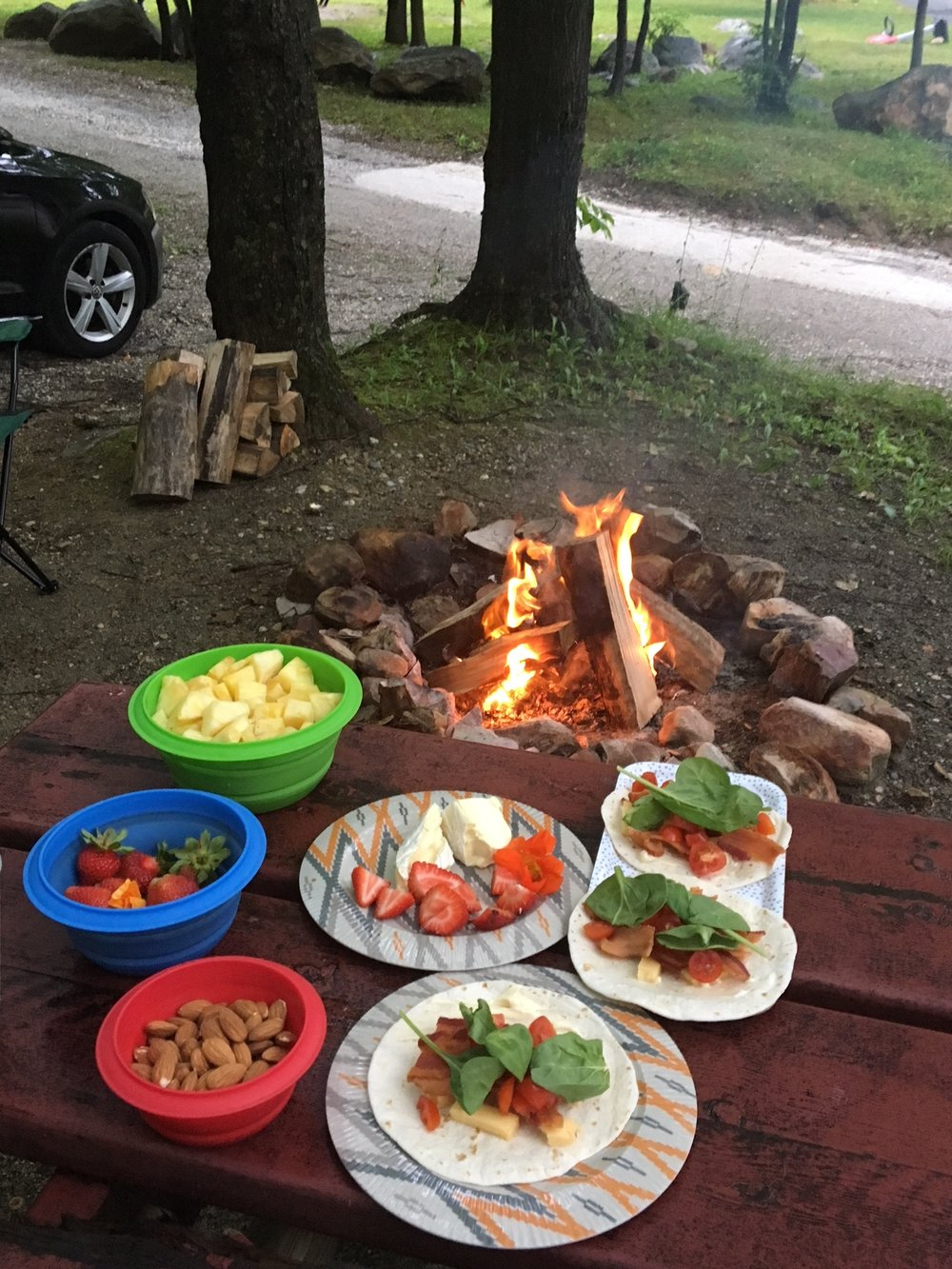 Bacon, cheddar, spinach and tomato wraps around the campfire. Pair with fruits, almonds and other snacks for a camping trip. Finger food at it's finest!