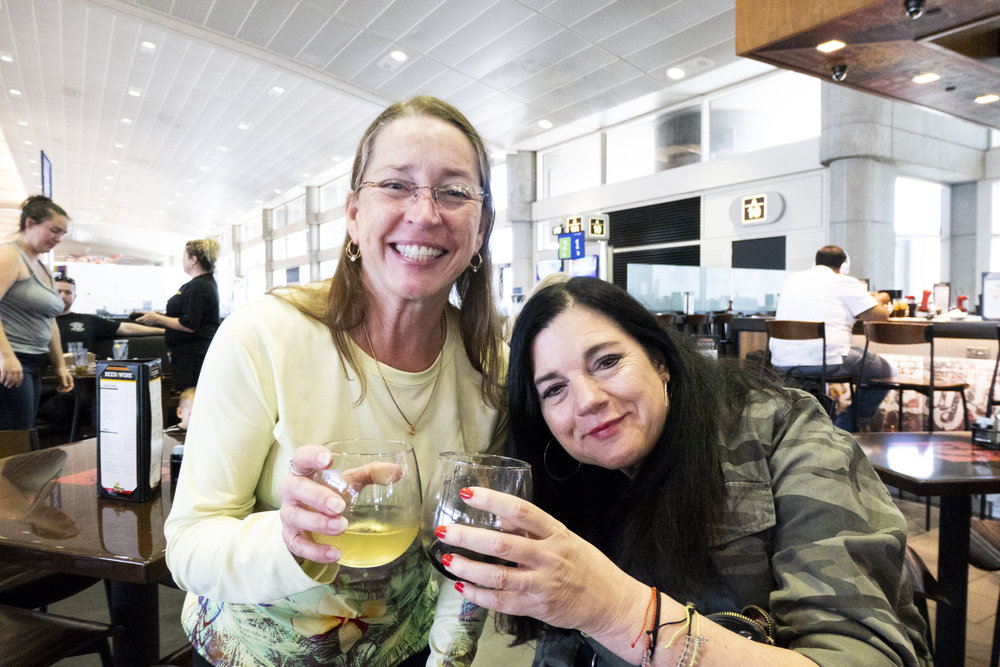 featured: Mindy (left), Karen (right) at the Tampa International Airport