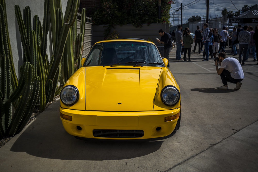 """This year however, Idelson and Long upped the ante and commissioned a car build that some are calling the """"Luft-auto."""" After kicking the idea around and telling some folks that it was under consideration, they realized they had to do it. Long donated a Porsche 911SC 3.2L, and Joey Seely from Emotion Engineering led the project. Rod Emory became involved too and the car is complete and recently shaken down, off road. You see, it's a safari-themed car designed for SoCal's active beach and mountain lifestyle.  Best of all, RM Sotheby's will be auctioning the car at Luftgekühlt. All proceeds beyond the 911's base value will benefit the Autumn Leaves Project, which seeks earlier detection and the ultimate cure of pancreatic cancer.  For more information on Luftgekühlt, click  here .  For more information on the Autumn Leaves Project, click  here ."""