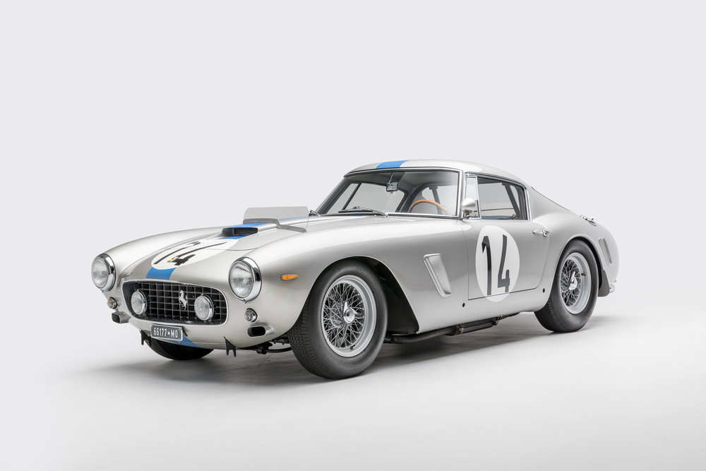 A silver and blue 1961 Ferrari 250GT SWB.