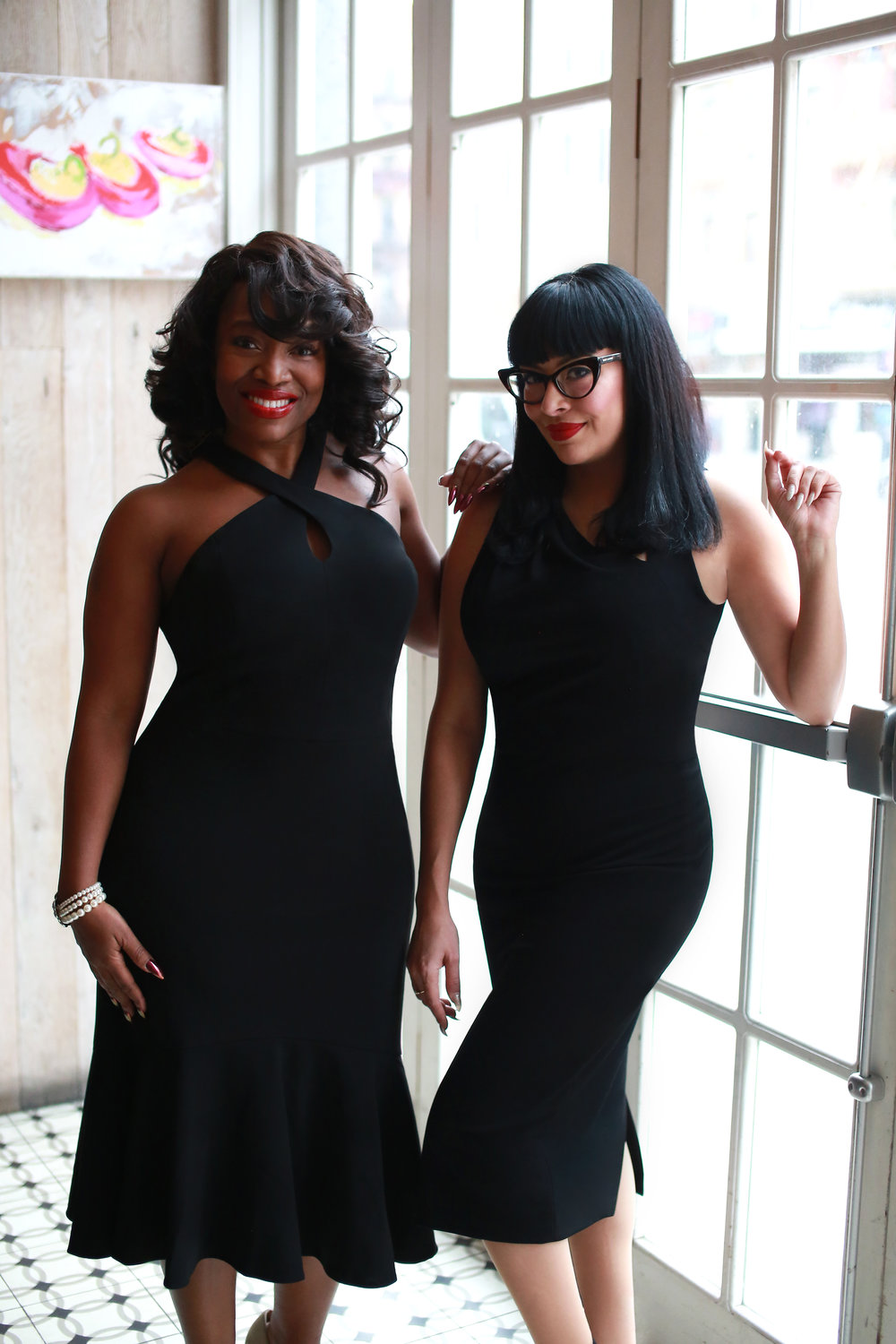 From left to right: Yoli is wearing our  Samantha Flounce , while Sabrina is wearing our  Tyra Midi .