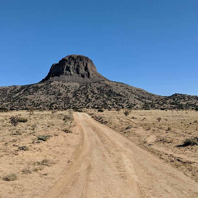 One of nearly fifty volcanic plugs along the Rio Puerco- but the only one we can see from our office :)