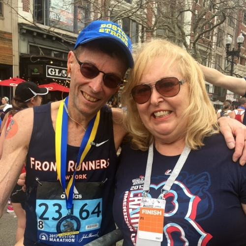 Paul poses in his Boston Strong cap with long-time finish line volunteer Dianne Massa after the 2017 Boston Marathon